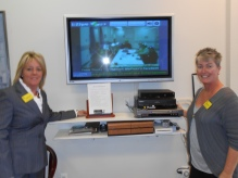 Tracey Wolfman (left) and Debbie with their GrandCare System in the center's common room.