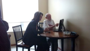 Knute Nelson client, Philip, using GrandCare touchscreen technology
